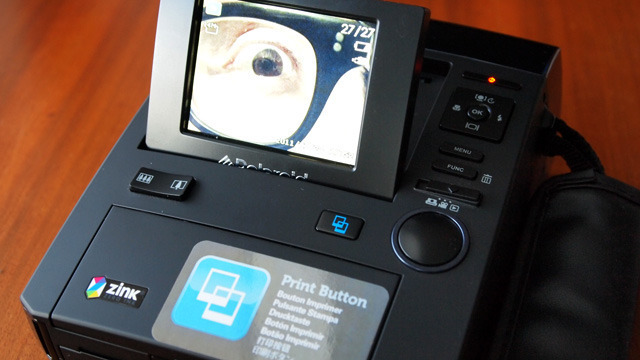 Popping up the LCD helps framing, but forces the user to use an unsteady grip.