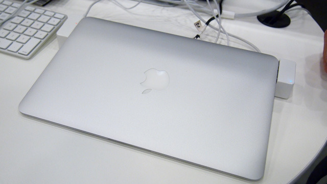 """An 11"""" MacBook Air connected to a LandingZone dock. Look closely and you can see the MagSafe LED charging indicator on the left, and LandingZone's LED power indicator on the right."""