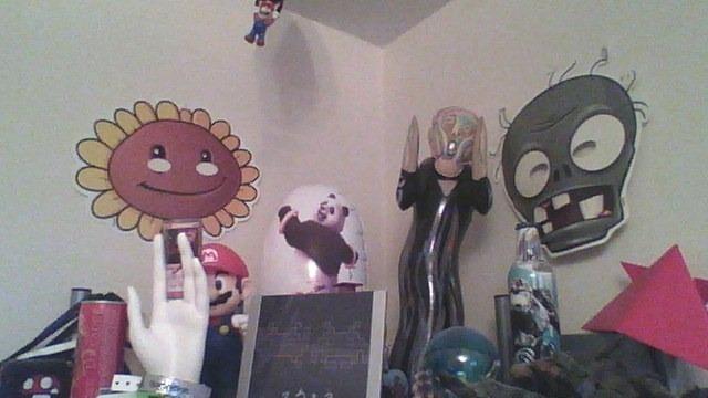 My desk's curio shelf, taken with the Vita's underpowered rear camera.