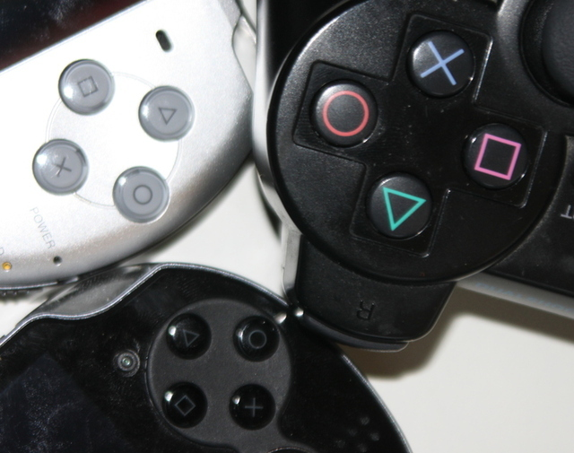 Button size comparison. Clockwise from top-left: PSP-3000, PS3 controller, Vita