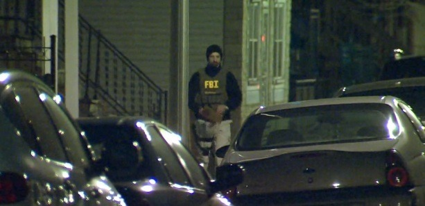 A still from video of the FBI raid on Hammond's apartment
