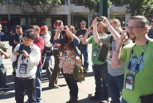 Bemused GDC attendees stop to take pictures of the protestors, who insulted the attendees' chosen profession continuously throughout.