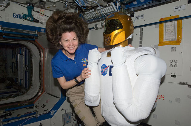 A robot like this one next to Astronaut Cady Coleman might be sufficient to handle refueling duties.