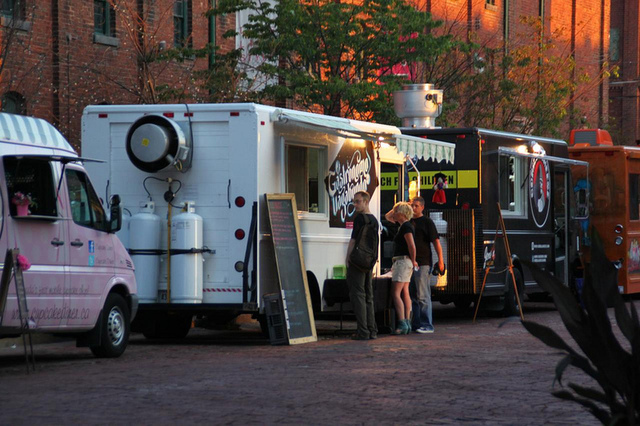 Food trucks gather at a planned event in downtown Toronto. They're a bit easier to locate when they're all in one place.