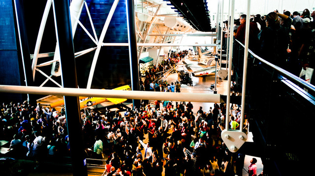 Crowds of people swarm the walkways to look at Discovery being moved into the McDonnell Space Hangar.