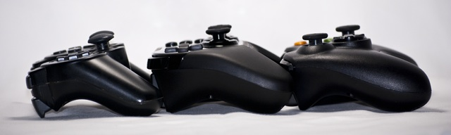 A motley crew, the Dualshock 3, the OnLive controller, and Xbox 360 gamepad side by side. OnLive's is the biggest, but it also enjoys the most balanced weight. The Dualshock 3 and 360 gamepad are both heaviest at the ends, where the motors are for rumble, but the OnLive controller feels centered.