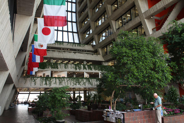 The flags of some of the nations participating at Fermi hang above the foliage that livens up the interior.