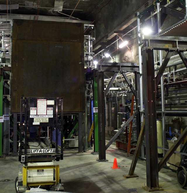 A bit of shielding stands between the source of neutrinos and the detector arrays.