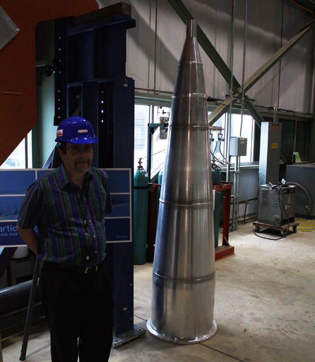 A focusing horn, used to create a beam of neutrinos, with physicist and Minos spokesman Rob Plunkett provided for scale.