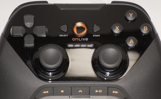 Upon closer inspection, it's easy to see the OnLive button, which brings up the main menu and the player number lighting. The analog sticks are also studded to increase grip, and the D-pad is rounded off at the center so players can roll a thumb in each direction.