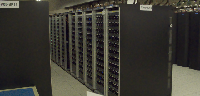 Large racks of disks sit between the tape archive and the grid and help handle fast access to data.