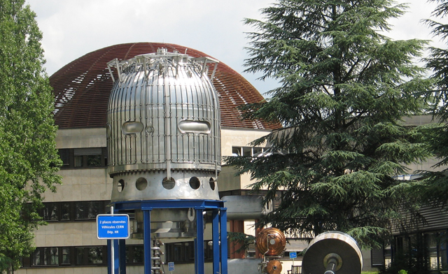 Some exotic-looking silver hardware rises in front of the CERN visitor's center (brown dome in backdrop).