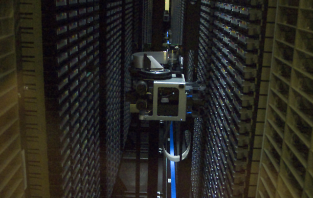 Robotic arms help get data onto and off of tapes at a reasonable pace.