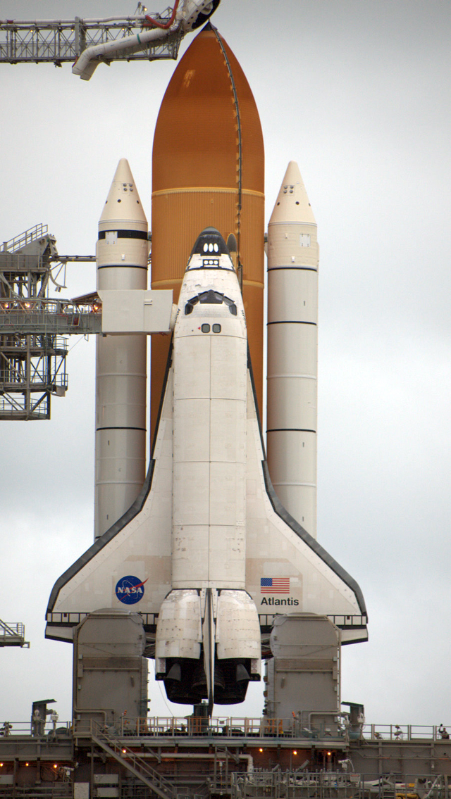 <em>Atlantis</em> and its launch stack.