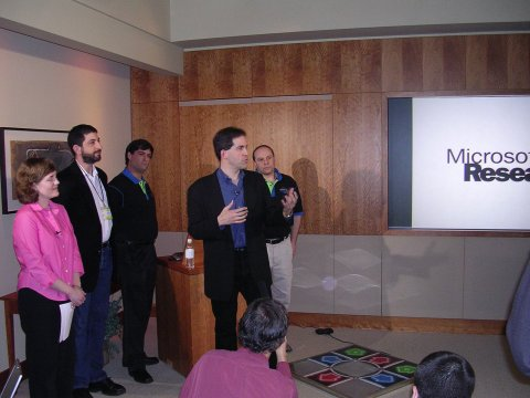 A group of Microsoft Researchers assembles to introduce the new technology.