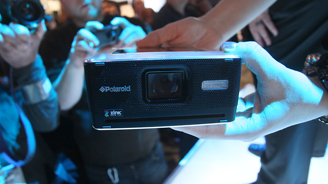 The GL30 attracted a lot of attention on the show floor. One Polaroid fanatic even snapped a picture of it using a vintage Polaroid 600 SLR.