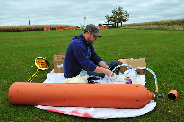"Jamey Erickson prepping the balloon, helium tank, and ""capsule"" for last Friday's launch."