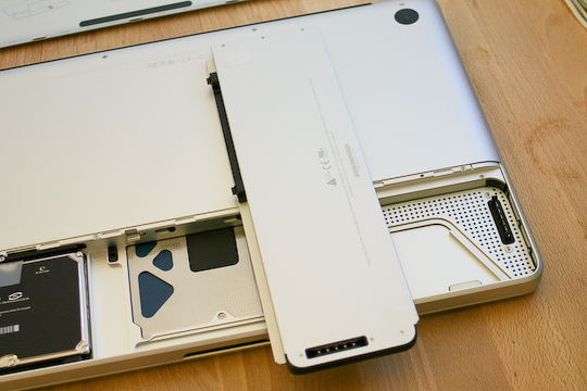 A small latch on the back of the MacBook Pro pops the compartment open
