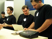 Apple Geniuses assist users at the Genius Bar inside every Apple Store.