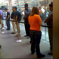 Customers still wait in line—much shorter than those in the first few weeks—to buy an iPhone 3G.