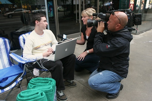 Andy Pichotta, first in line at Apple's Micigan Ave retail store, gets interviewed by WGN9 News.