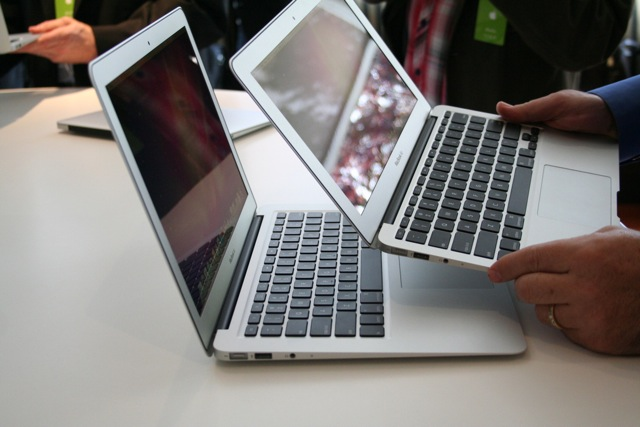 """Holding the 11.6"""" MacBook Air over the 13.3"""" version"""