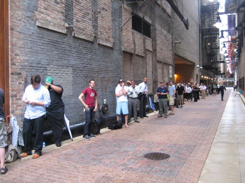 A line around the corner and down the alley at a Chicago AT&T retail store