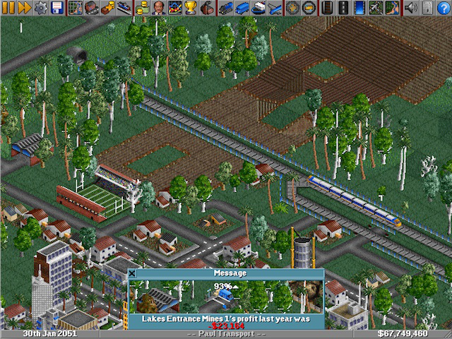 """<em>OpenTTD</em>. This screenshot was taken using a saved game file available <a href=""""http://easttown.co.uk/TTDX/TTFile.php?f=111"""">here</a>."""