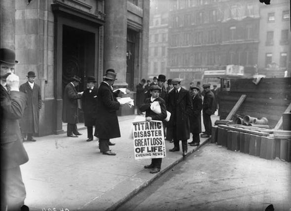 Paper boy spreading news of the <em>Titanic</em> disaster.