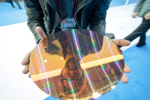 That's me, holding a wafer of 22nm Bay Trail chips. This image serves no purpose other than it looks awesome.