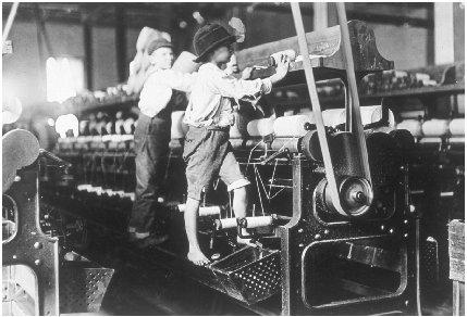 Children working a large machine, during the Industrial Revolution