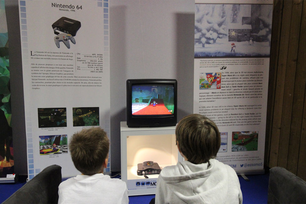 Some kids playing on an N64. They weren't alive when the N64 first came out...