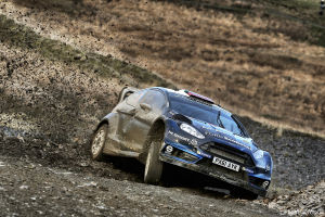Trying to go around a muddy, rainy, gravelly corner at high speed is... difficult. Here Elfyn Evans shows how it's done.