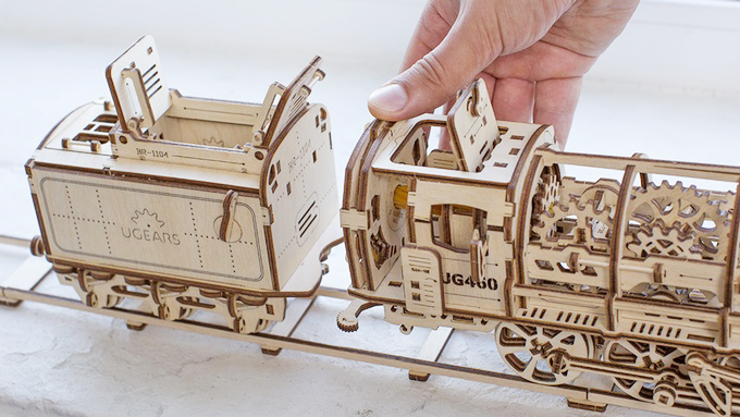 Ugears automotive, made entirely out of wood, without glue or tools.