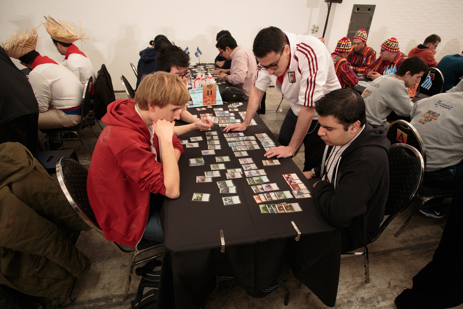 Team Sealed starts with each team opening a bunch of packs and then trying to turn the (random) cards into useful decks. England is pictured here; team captain Fabrizio Antaeri is the one standing up.