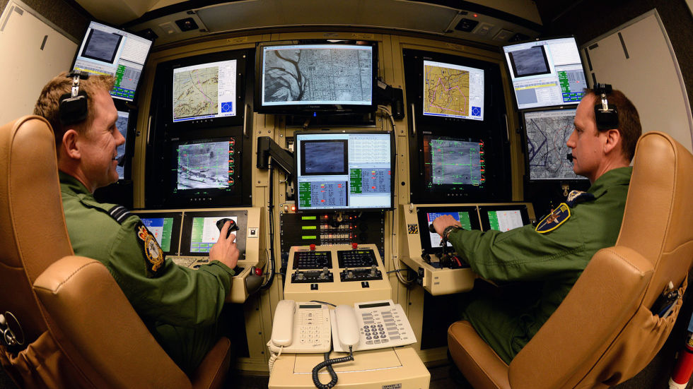 Two drone pilots at the RAF's new ground control station in Waddington, England.