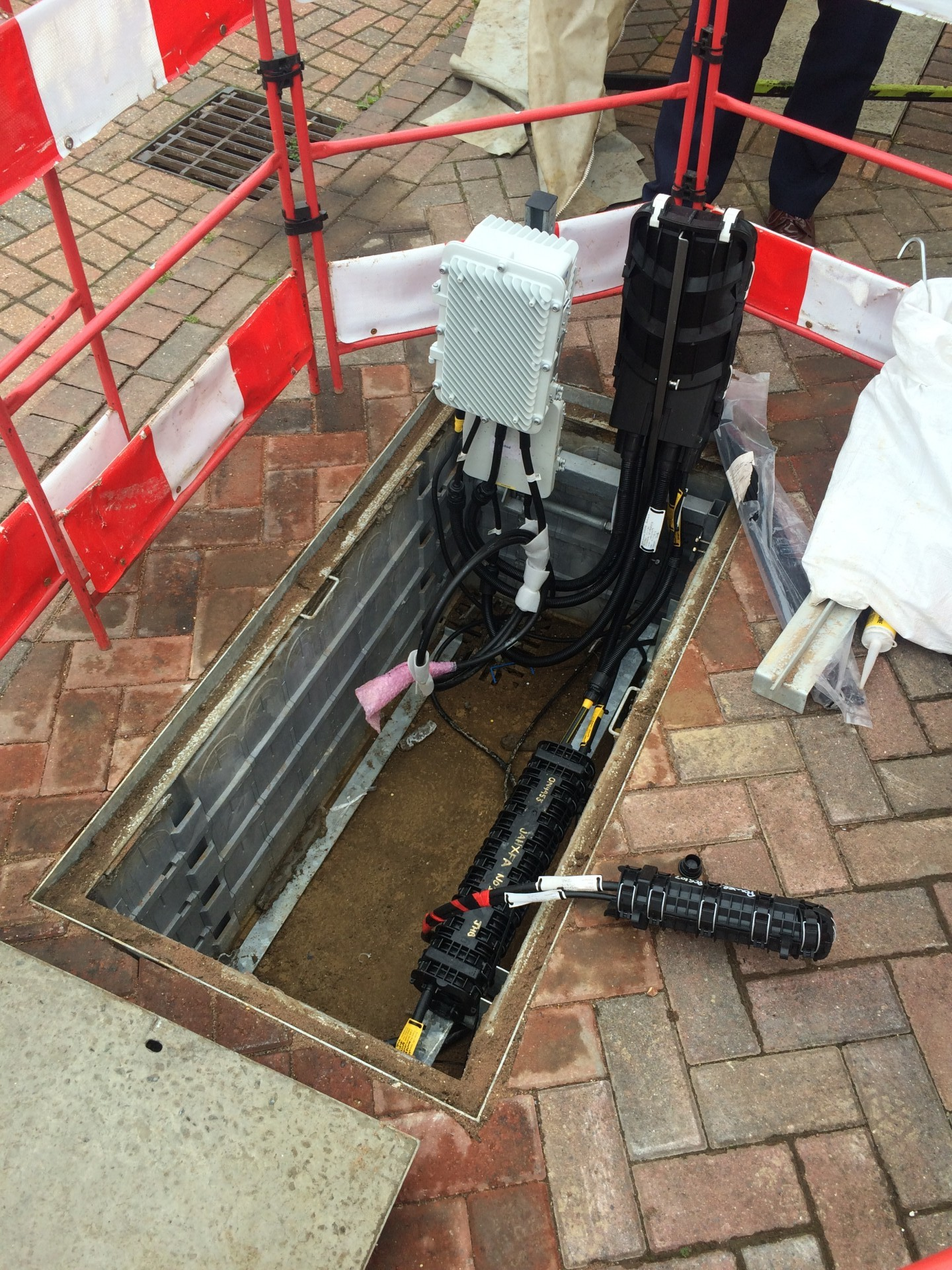 The white-grey box is an under-pavement DSLAM from a UK G.fast trial.