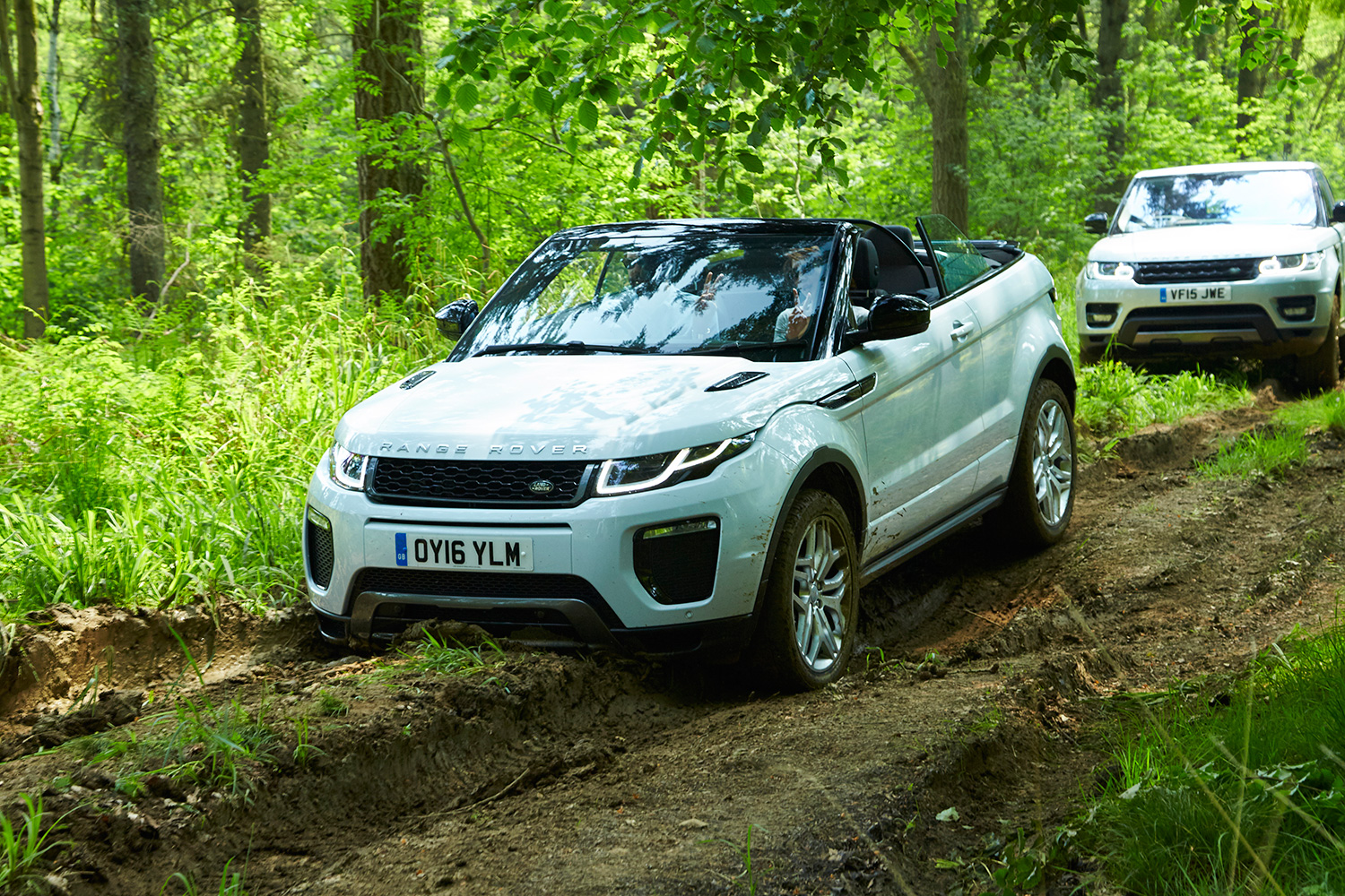 Me driving the Evoque Convertible down a muddy track. You can see the car's low clearance; the front fender is scooping up some mud.