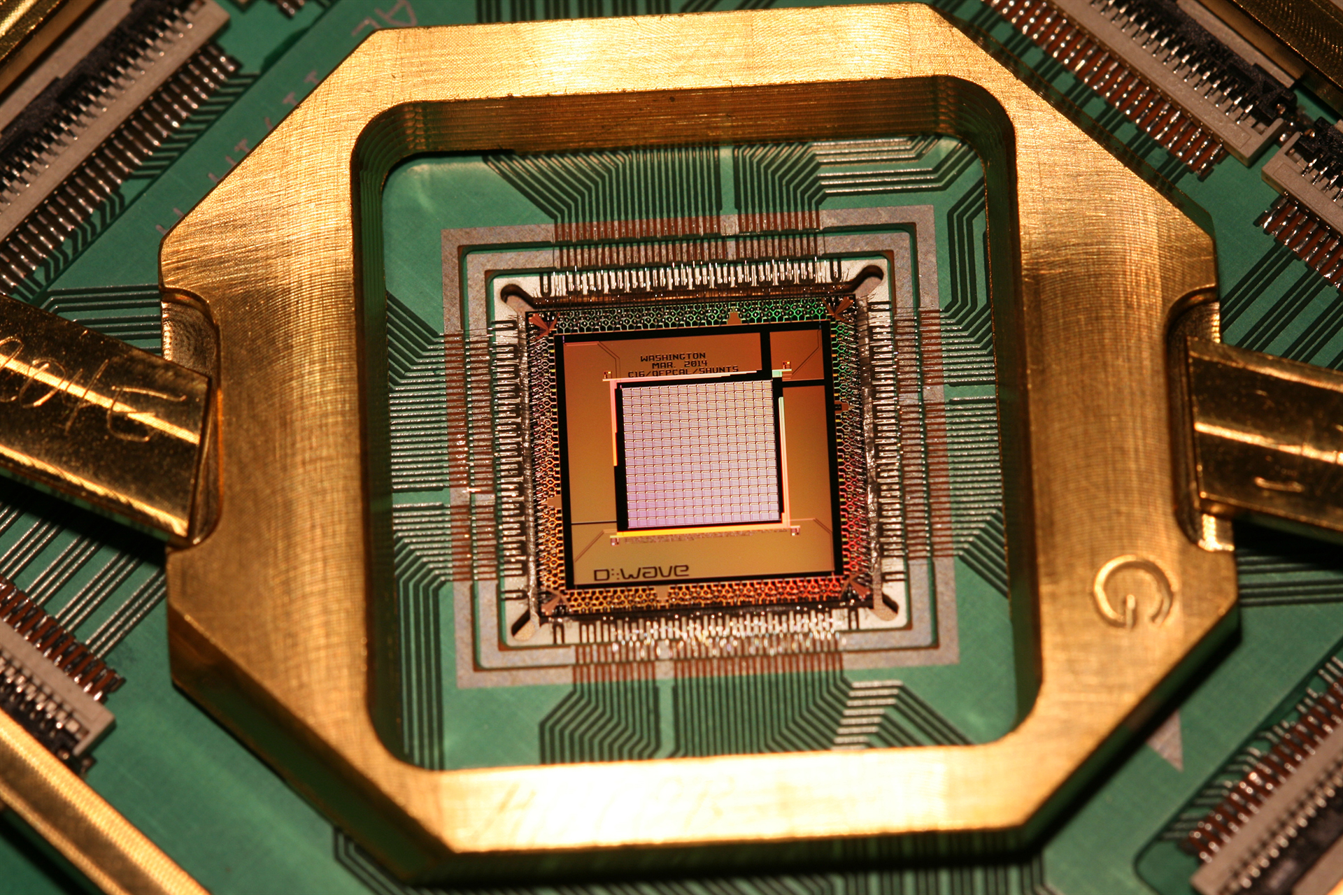 "A D-Wave computer chip (which <a href=""http://arstechnica.co.uk/science/2016/02/is-d-waves-quantum-processor-really-108-times-faster-than-a-normal-computer/"">may or may not be capable of quantum computing</a>)."
