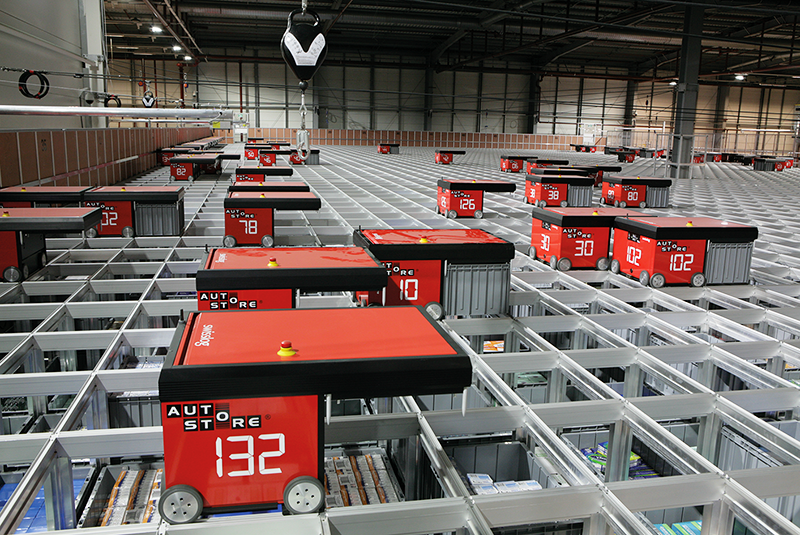 Swisslog AutoStore grid-based bin selection system installed at an Asda warehouse.