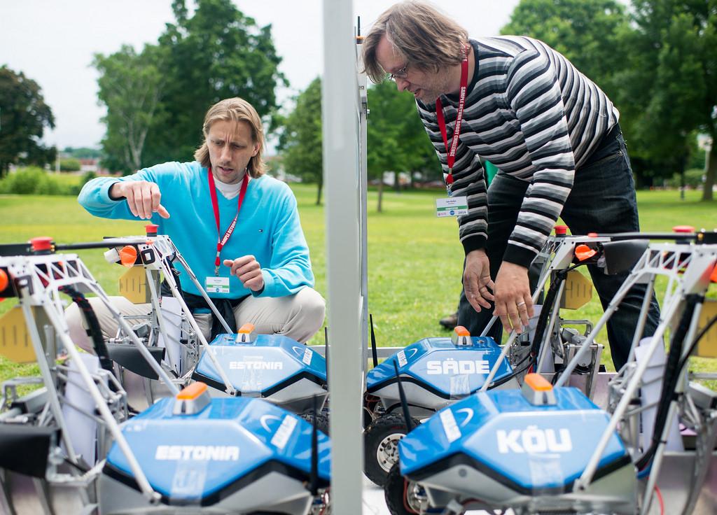 Ahti Heinla and Sulo Kallas prepare team KuuKulgur's robot during the 2014 NASA Centennial Challenges Sample Return Robot Challenge.
