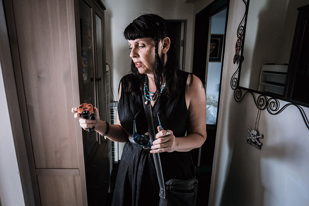 Birgitta Jónsdóttir, a Pirate Party MP in Iceland, holds the ashes of her late mother in her home.