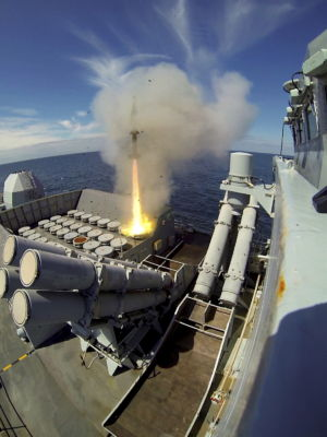 A Sea Wolf surface to air missile leaves the launcher onboard Type 23 frigate HMS Montrose during an exercise. You can see the twin quad-Harpoon missile batteries.