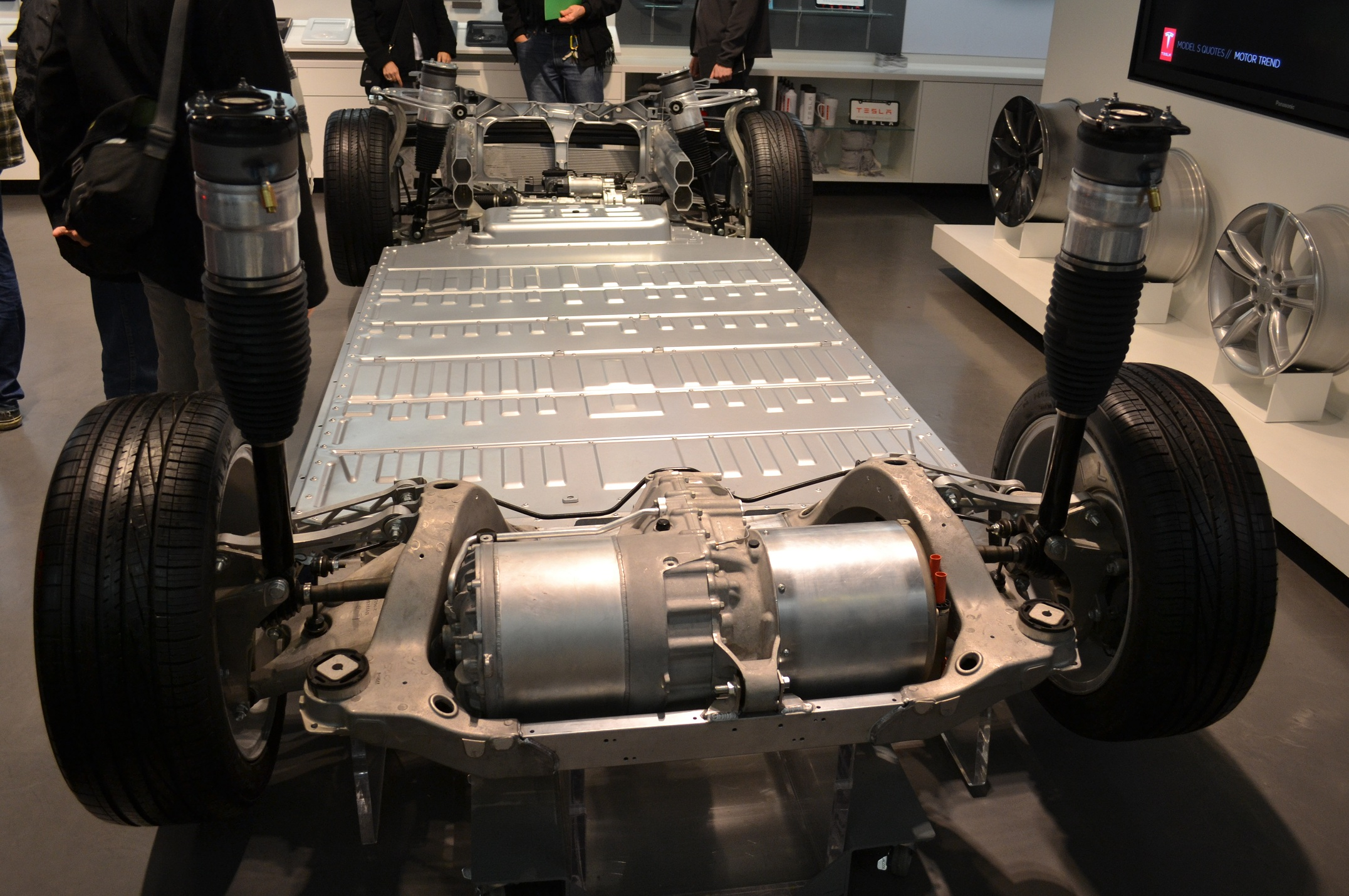 A rolling chassis of the Tesla Model S - the battery, wheels, motors, and not much else.