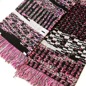 "The ""Melissa"" scarf, featuring most of the binary code of the Melissa malware, which first appeared in 1999."