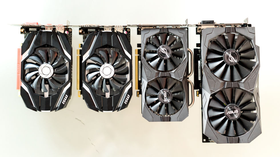 MSI's GTX 1050 and 1050 Ti on the left, and Asus' RX 460 and RX 470 on the right.