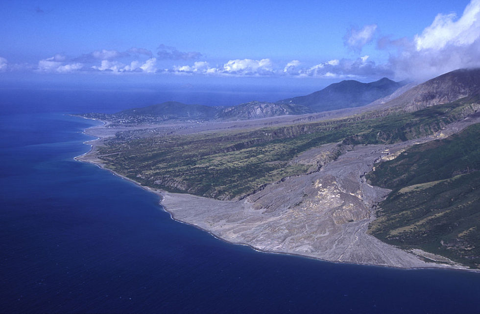 Aerial view of the slopes of the Soufrière Hills, showing the destruction and complete loss of the capital of Monserrat, Plymouth, and St. Patrick's village.