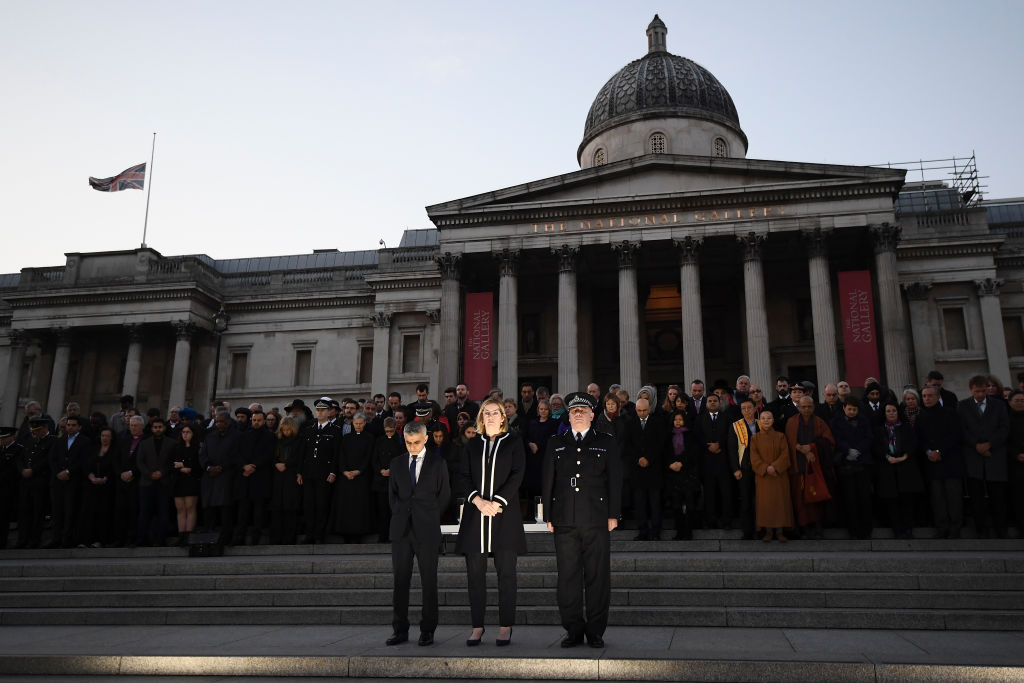 Mayor of London Sadiq Khan, home secretary Amber Rudd, and acting Scotland Yard chief Craig Mackey stand in silence during a candlelit vigil to remember the victims of the Westminster attack.