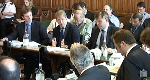 Charles Farr (centre) seen during a rare public appearance before the Home Affairs Select Committee in 2012.