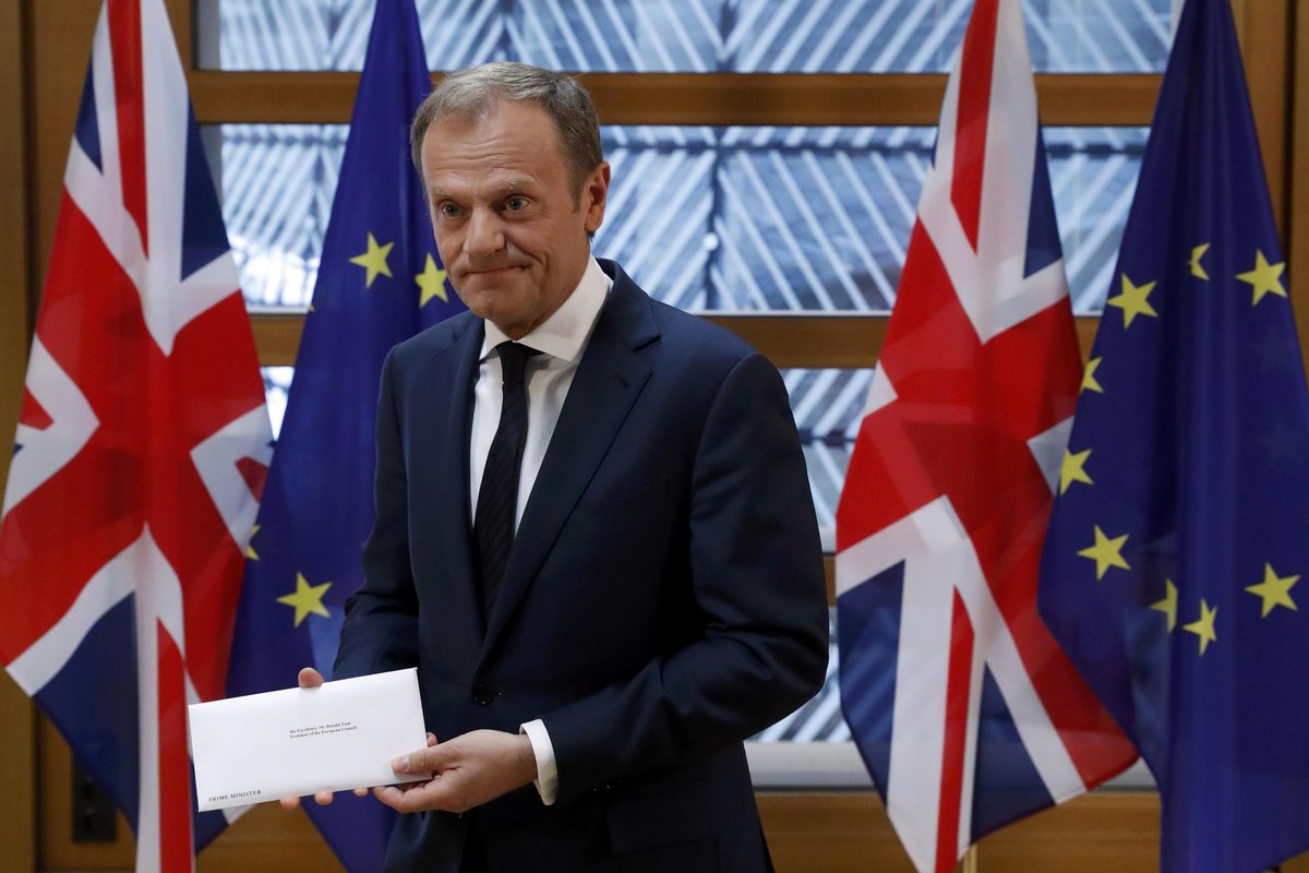 The current president of the European Council, Donald Tusk, receiving the UK's Article 50 letter.